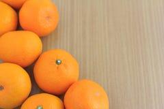 Fresh raw orange. Many fresh oranges on wood table Royalty Free Stock Photos
