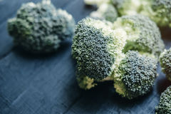 Fresh raw organic broccoli on black wooden table. top view.  Royalty Free Stock Photo
