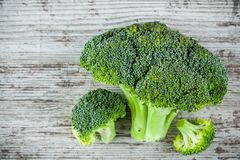 Fresh raw organic broccoli on a wooden background. Top view Stock Photography