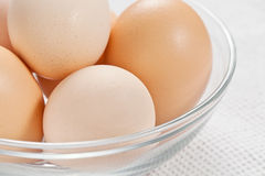 Fresh raw organic eggs in glass bowl Stock Image