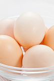 Fresh raw organic eggs in glass bowl Royalty Free Stock Photo