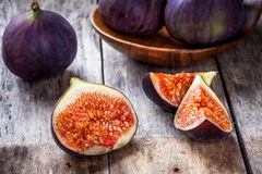 Fresh raw organic figs. On a wooden background Royalty Free Stock Photography