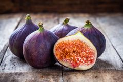 Fresh raw organic figs. On a wooden background Royalty Free Stock Image