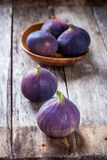 Fresh raw organic figs. On a wooden background Stock Image