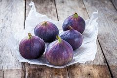 Fresh raw organic figs. On a wooden background Stock Photography
