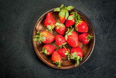 Fresh raw organic homemade strawberry. On plate on a dark gray concrete stone table,copy space Royalty Free Stock Photos