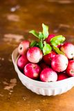 Fresh raw organic red apples in a bowl on a wooden table, selective focus. Harvesting time. Healthy and organic food option Stock Photos