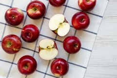 Fresh raw organic red apples on cloth over white wooden background, top view. Flat lay, from above, overhead.  stock photo