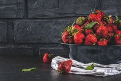 Fresh raw organic strawberry. Dark stone background copy space Royalty Free Stock Photos
