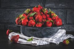 Fresh raw organic strawberry. Dark stone background copy space Royalty Free Stock Photography