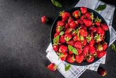 Fresh raw organic strawberry. Dark stone background copy space top view Royalty Free Stock Images
