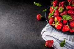 Fresh raw organic strawberry. Dark stone background copy space top view Royalty Free Stock Photography