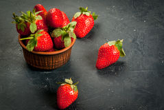 Fresh raw organic strawberry. Fresh raw organic homemade strawberry on a dark gray concrete stone table,copy space Stock Photos