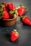Fresh raw organic strawberry. Fresh raw organic homemade strawberry on a dark gray concrete stone table,copy space Royalty Free Stock Image