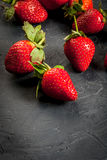 Fresh raw organic strawberry. Fresh raw organic homemade strawberry on a dark gray concrete stone table,copy space Royalty Free Stock Photography