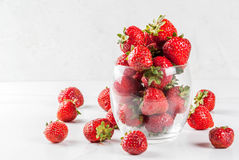 Fresh raw organic strawberry. Summer berries and fruit. Fresh raw organic strawberry in drinking glass on white marble table, copy space Stock Photography