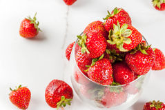 Fresh raw organic strawberry. Summer berries and fruit. Fresh raw organic strawberry in drinking glass on white marble table, copy space Royalty Free Stock Images