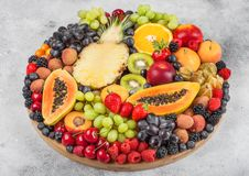 Fresh Raw Organic Summer Berries And Exotic Fruits In Round Large Tray On Light Kitchen Background. Papaya, Grapes, Nectarine, Royalty Free Stock Images