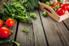 Fresh raw organic vegetables on a rustic wooden table Stock Photo