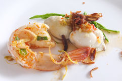 Fresh raw oyster and shrimp with spicy sauce, thai style seafood. On white dish Royalty Free Stock Photography