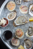 Fresh raw oysters on ice. With lemon Royalty Free Stock Image