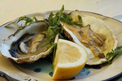 Oysters plate. Fresh raw oysters and lemon, typcal neapolitan starter Royalty Free Stock Images
