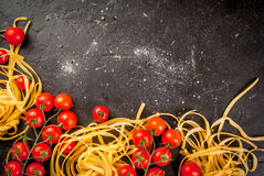 Fresh raw pasta with tomatoes Royalty Free Stock Photo