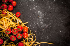 Fresh raw pasta with tomatoes Stock Photos