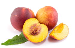Fresh raw peaches on white. Fruit background Royalty Free Stock Images