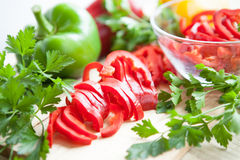 Fresh raw peppers sliced ​​and whole. Ripe vegetables Stock Photography