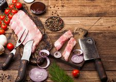 Free Fresh Raw Pieces Of Pork Ribs On Chopping Board And Vintage Meat Hatchet, Fork And Knife On Wooden Background. Fresh Tomatoes And Royalty Free Stock Image - 141565676