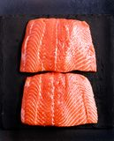 Fresh, raw pieces of salmon. On board Royalty Free Stock Photo