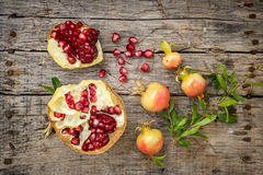 Fresh raw pomegranate. Cute small pomegranate on wooden background Stock Photos