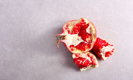 Fresh raw pomegranate over grey background. Top view Royalty Free Stock Images