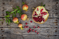Fresh raw pomegranate. On wooden background Stock Image