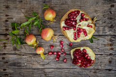 Fresh raw pomegranate. On wooden background Royalty Free Stock Images