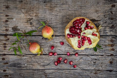 Fresh raw pomegranate. On wooden background Royalty Free Stock Photos