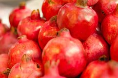 Fresh raw pomegranates fruit display on market stall. In Malaysia.Selective focus shot Royalty Free Stock Photo