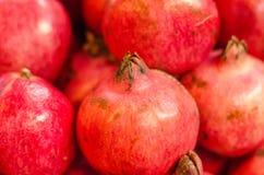 Fresh raw pomegranates fruit on market stall in Malaysia. Selective focus shot Stock Image