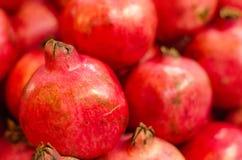 Fresh raw pomegranates fruit on market stall in Malaysia. Selective focus shot Stock Photos