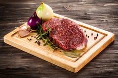 Fresh raw pork. Fresh raw beef on cutting board Stock Photography