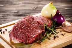 Fresh raw pork. Fresh raw beef on cutting board Stock Photos