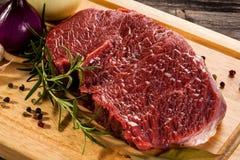Fresh raw pork. Fresh raw beef on cutting board Royalty Free Stock Photos