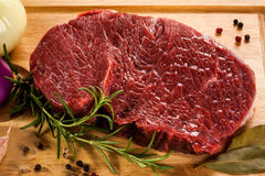 Fresh raw pork. Fresh raw beef on cutting board Royalty Free Stock Image
