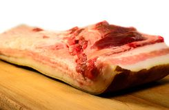 Fresh raw pork belly. On a wooden board Stock Images