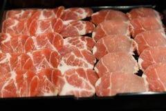 Fresh raw pork on Black background royalty free stock photos