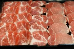 Fresh raw pork on Black background royalty free stock photo
