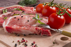 Fresh raw pork chop meat on cutting board Stock Photo