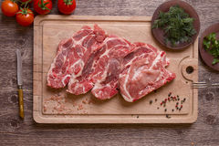 Fresh raw pork chop meat on cutting board Royalty Free Stock Photography