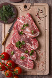 Fresh raw pork chop meat on cutting board Royalty Free Stock Photos